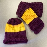 Maroon hat with yellow stripe and coordinating scarf.